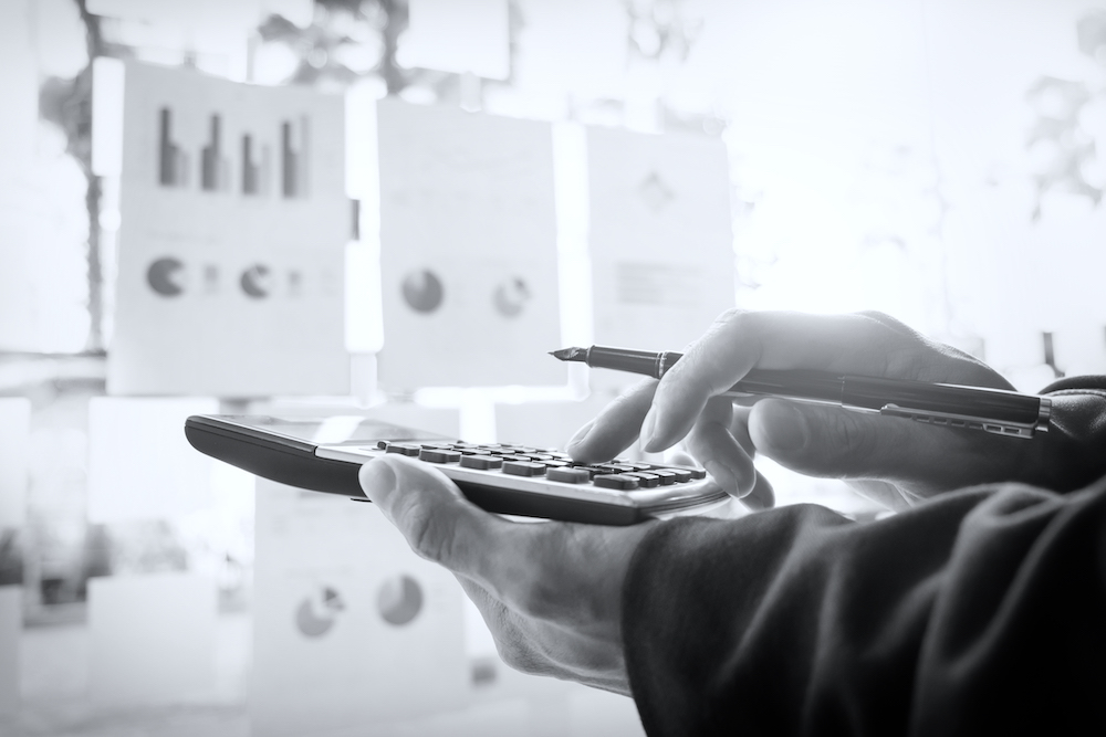 Business finance man calculating budget numbers, Invoices and financial adviser working