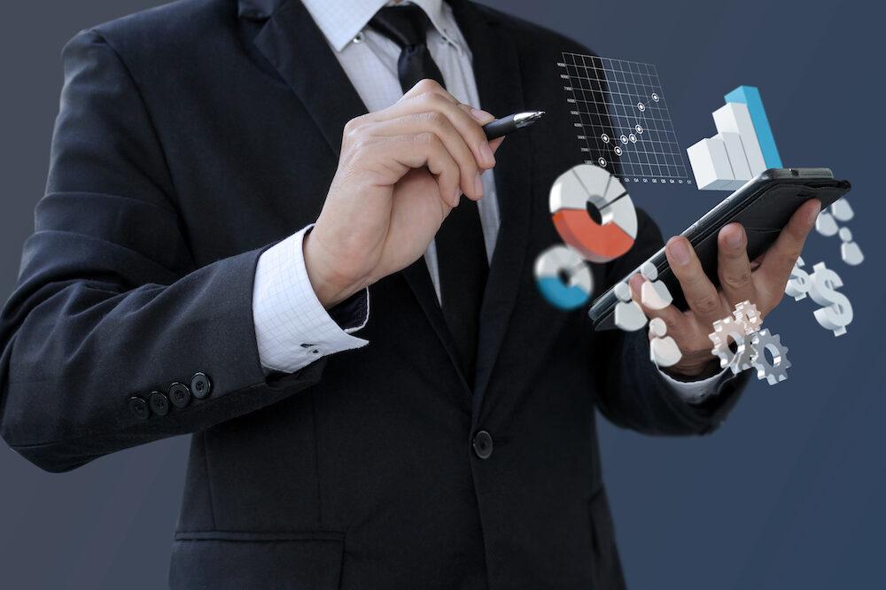 Businessman analytics information financial on smartphone