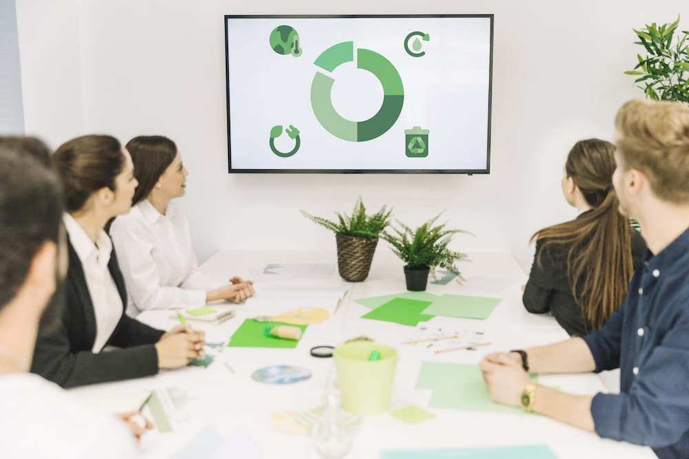 group-of-businesspeople-looking-at-natural-resources-icon-in-meeting
