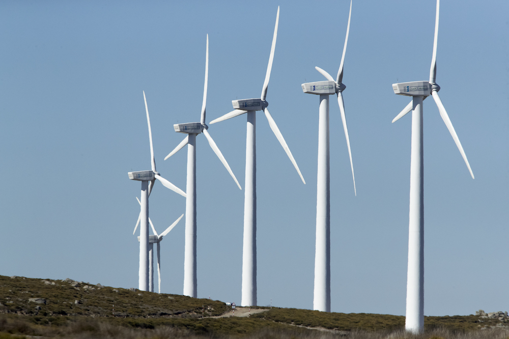 wind-turbines-on-mountainous-divide-producing-electricity-by-the-force-of-the-wind