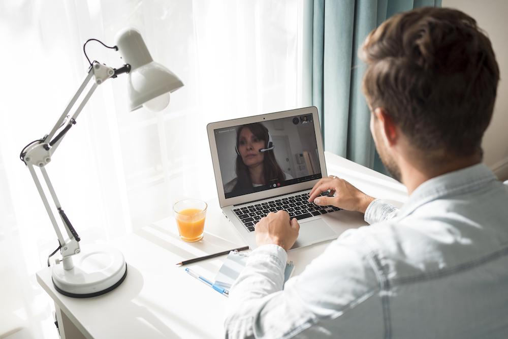 casual-adult-male-video-conferencing-at-home