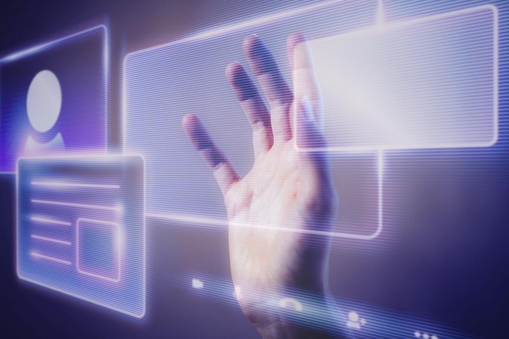 Woman touching a smart technology holographic interface