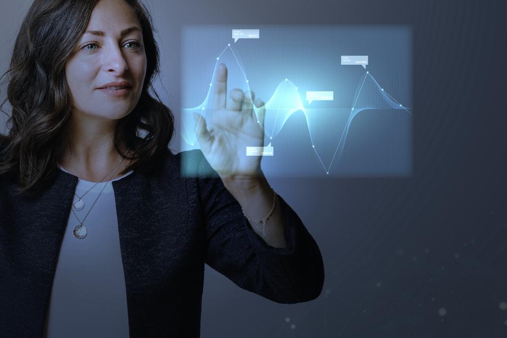 High technology digital graph presentation by a businesswoman